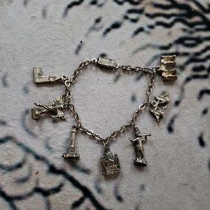 Silver charm bracelet building statues vintage
